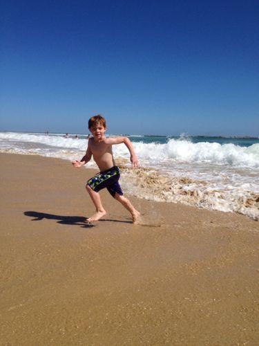 Asher running on beach