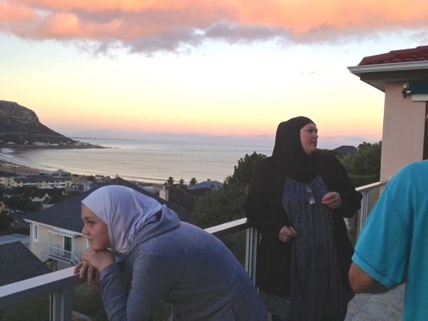 The Khan family on our balcony at sunset. (This is looking eastward)